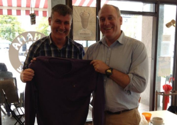 Dundalk manager Stephen Kenny has his jumper returned to him by Stephen Egan of Panama Café