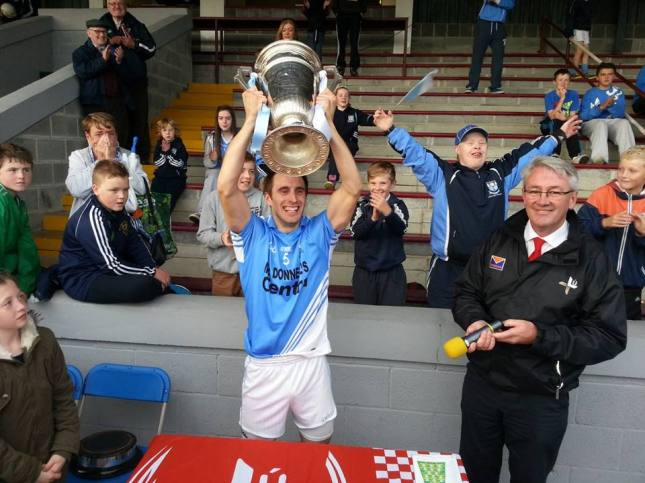 Newtown Blues' Stephen Moonan lifts the Joe Ward Cup after his side's victory over Cooley Kickhams