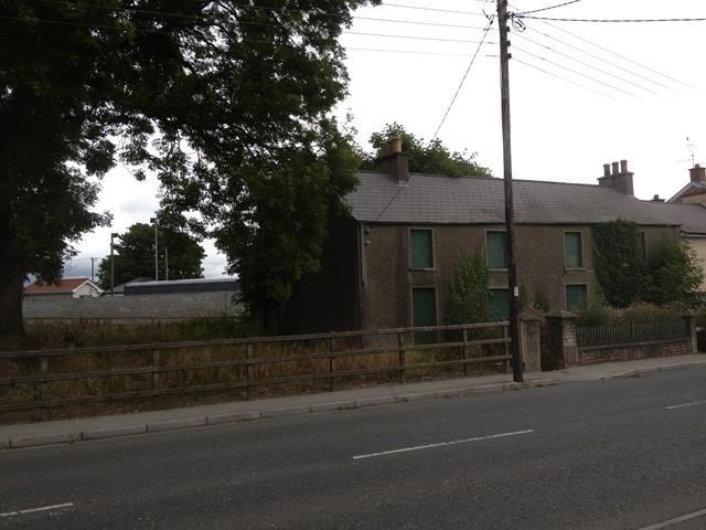 The derelict building that fronts onto the road of the 20 acres of land