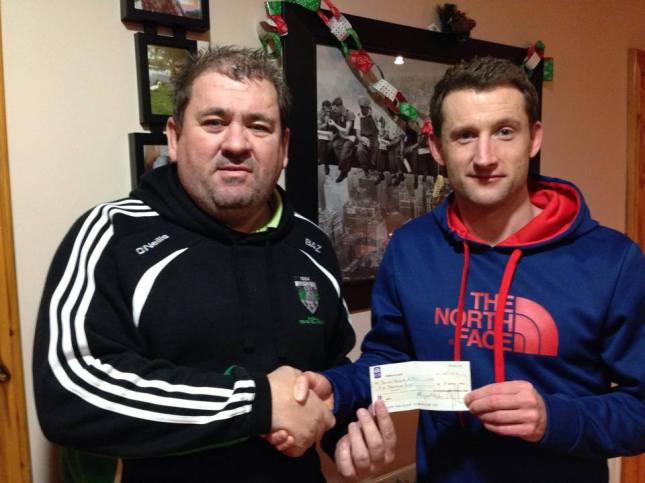 Aaron Rogers (right) making a €2,500 donation to Dundalk Young Irelands treasurer Barry McDermott