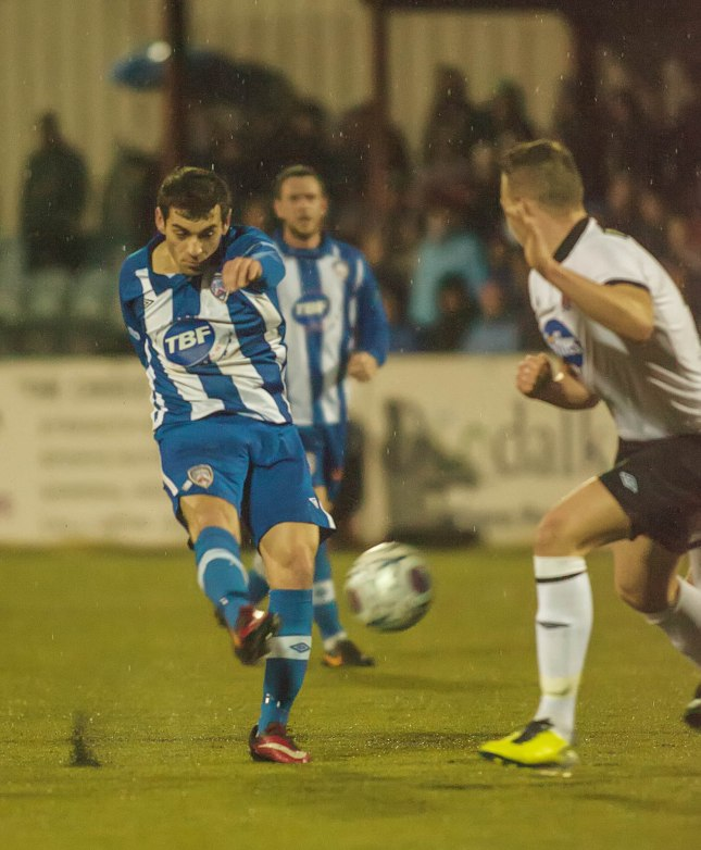 Andy Boyle can do little as Jim McDaid rifles home a world class equaliser for Coleraine at Oriel Park last night