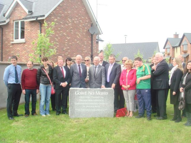 Officials, politicians and residents at the official opening of Goirt na Mara in Blackrock yesterday