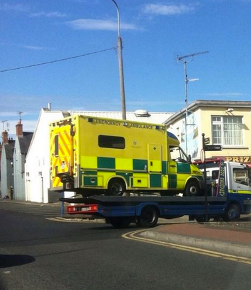An ambulance being towed up River Lane in Dundalk earlier this year