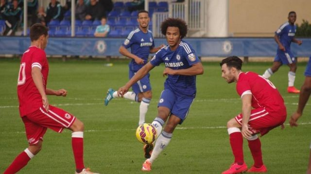 Richie Towell (right) closes in on Chelsea goalscorer Izzy Brown in their clash at Cobham yesterday