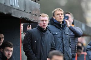 Paul Scholes and Philip Neville in the dug out for Salford City last weekend