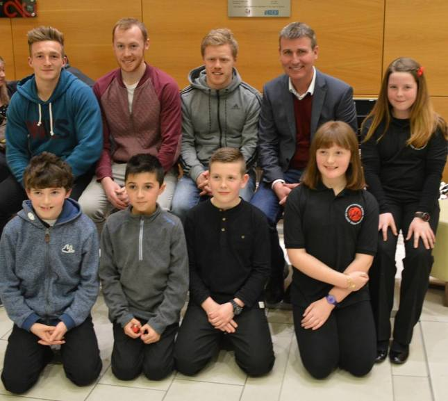 Dundalk FC players John Mountney, Chris Shields and Daryl Horgan with manager Stephen Kenny and local kids at the launch of the St Patrick's Day parade. Kenny will be this year's Grand Marshal
