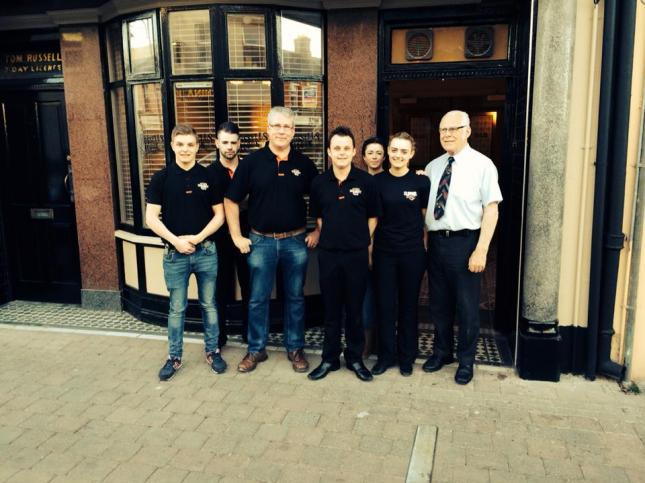 Greg Gormley (third from left) with staff on the opening night of Russell's in April