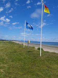 Flags flying at Port Beach in Clogherhead